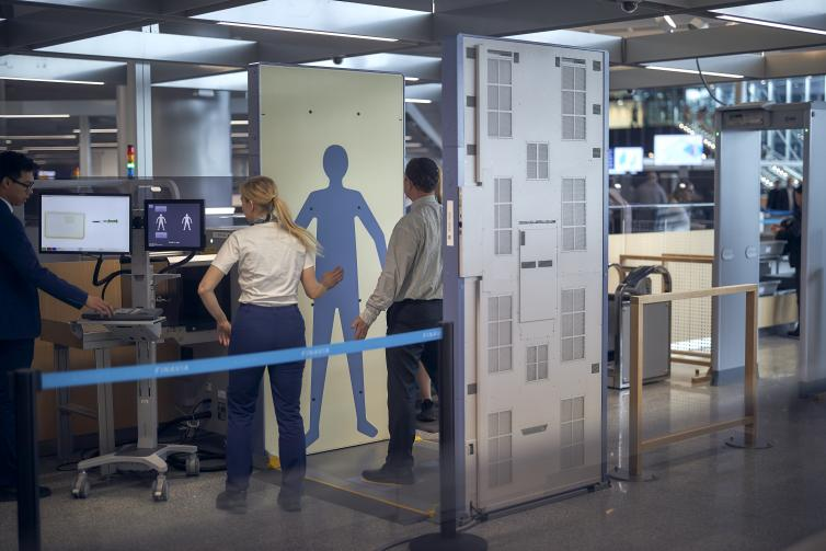 Passenger being security screened.