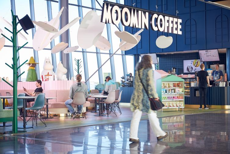 Passenger passing by Moomin Coffee front.