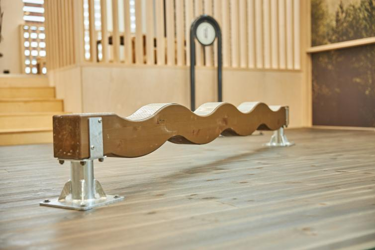 Wooden wavy balance beam at Maja Lounge.