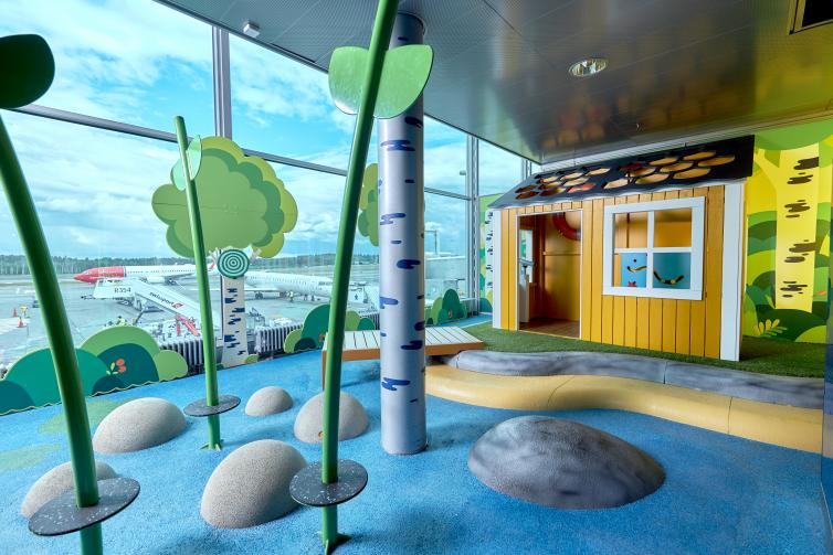 Children's play area that imitates Finnish cottage and nature.