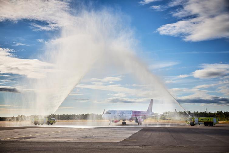 Wizz Air airplane getting a water salute.