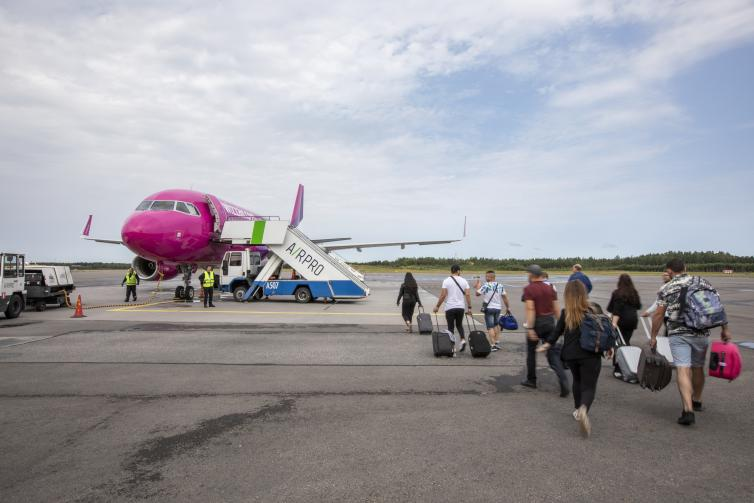 Passengers boarding Wizz Air's airplane.