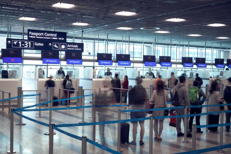 People lining up at Helsinki Airport Passport Control.