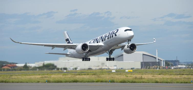 Finnair Airbus A350 taking off on a clear day.