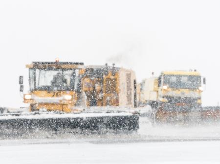 Cleaning snow on runway.
