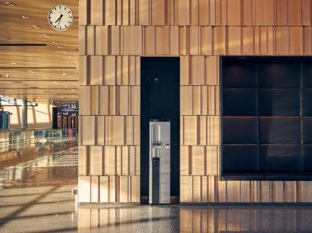Water automat and 3D wood panel wall.