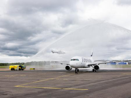 Finnair airplane receiving water salute.