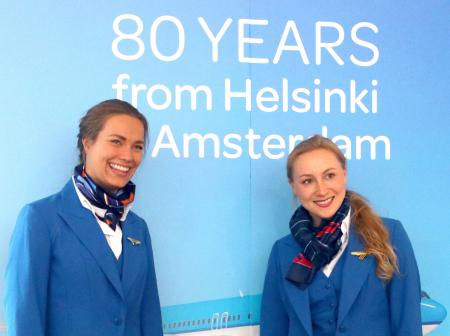 KLM airline staff posing for pictures at KLM 80 years celebration event.