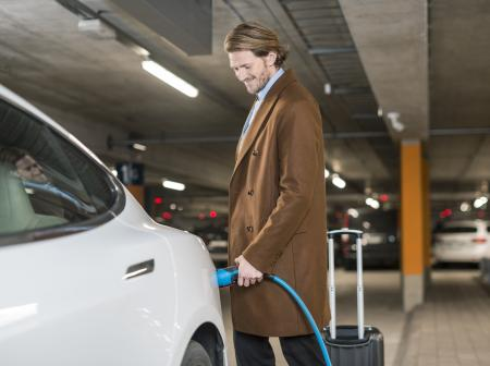 Men charging an electric car