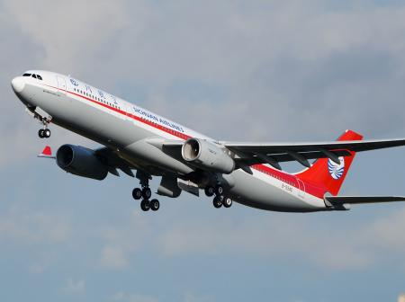 Sichuan Airlines airplane taking off.