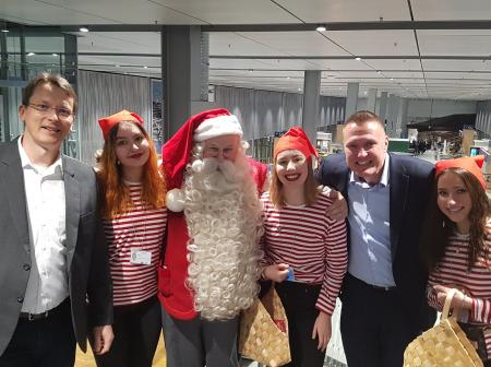 Santa claus and a group of guests at Finnair's route openning