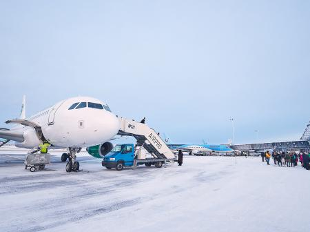 Aeroplane at snowy airport.