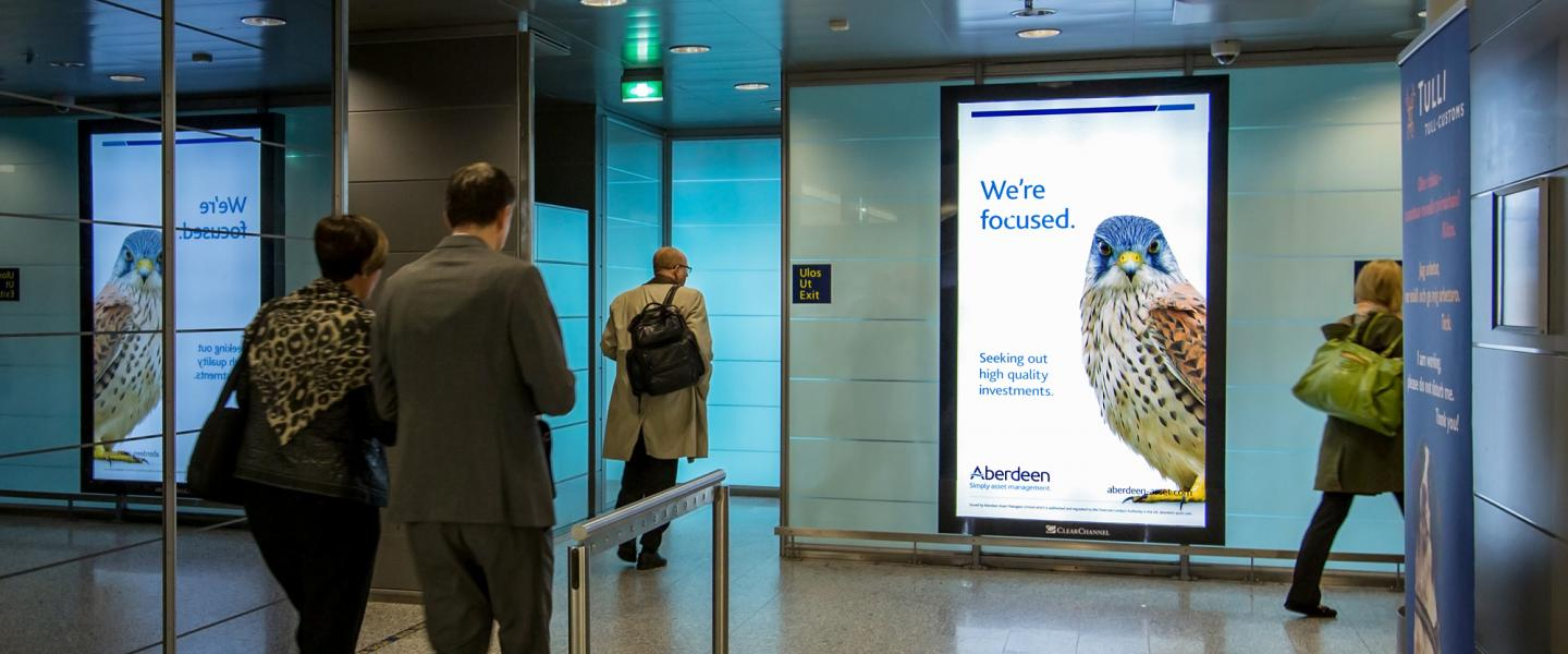 An advertisement at Helsinki airports baggage claim hall