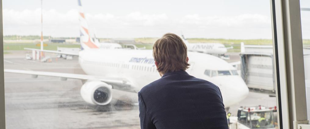 Businessman watching airplanes