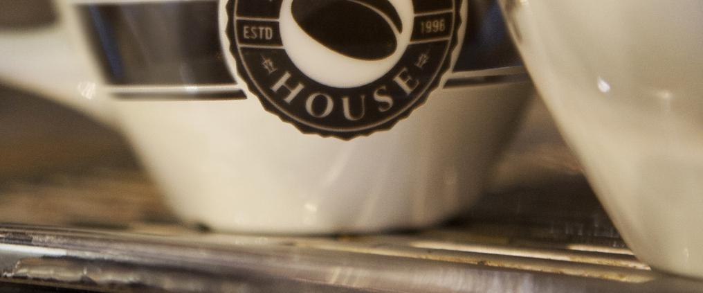 Close up of a coffee mug with Espresso House logo.