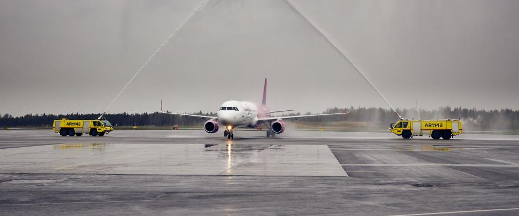 Airplane receiving a water salute.