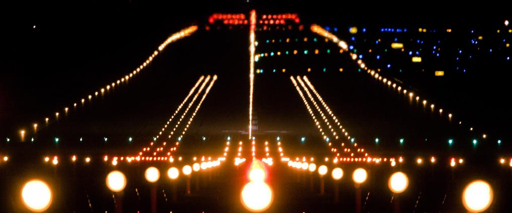 The runway lights during night.