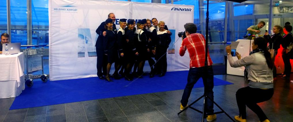 Finnair crew getting photographed for press during Miami route opening ceremony..
