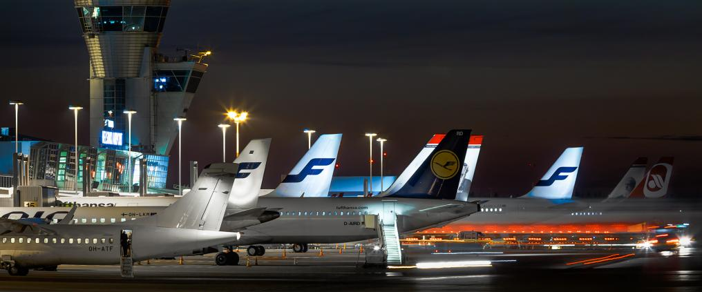 Airplanes at Helsinki Airport at night.
