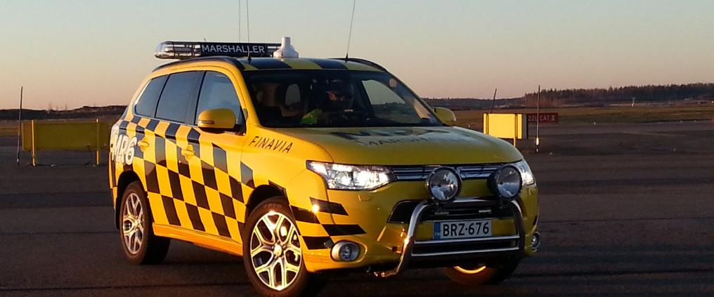 Yellow Mitsubisi Outlander car of Helsinki airport's marshallers.