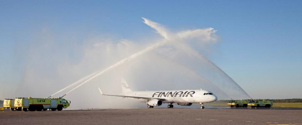 Water being sprayed onto an airplane.