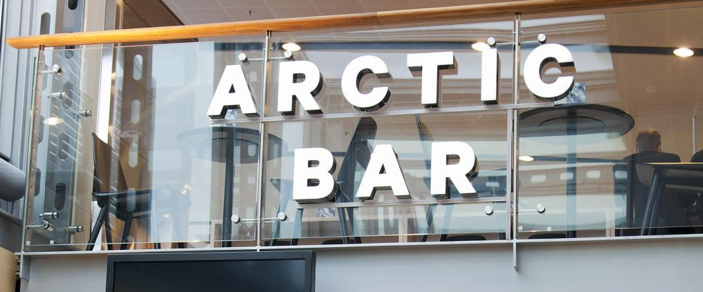 Arctic Bar sign on a glass railing