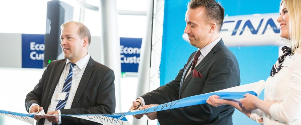Ceremonial ribbon cutting during Fukuoka route opening ceremony at Helsinki Airport.