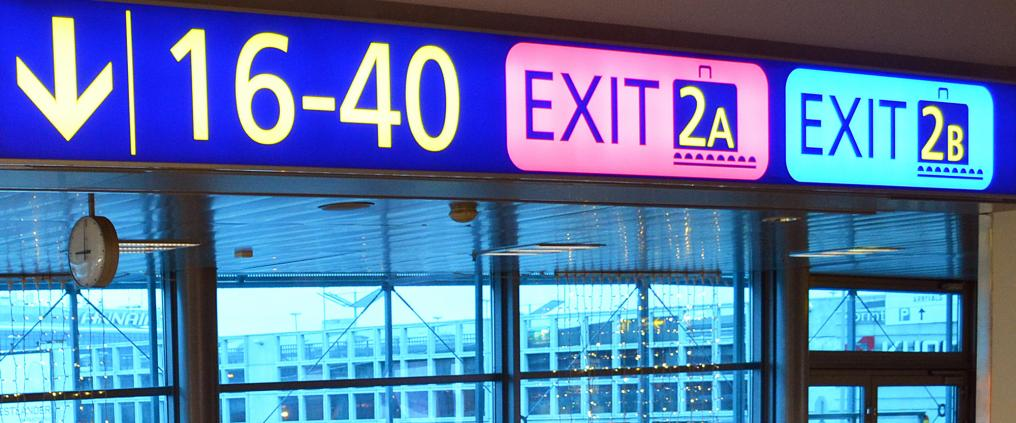 Exit signs at Helsinki Airport.