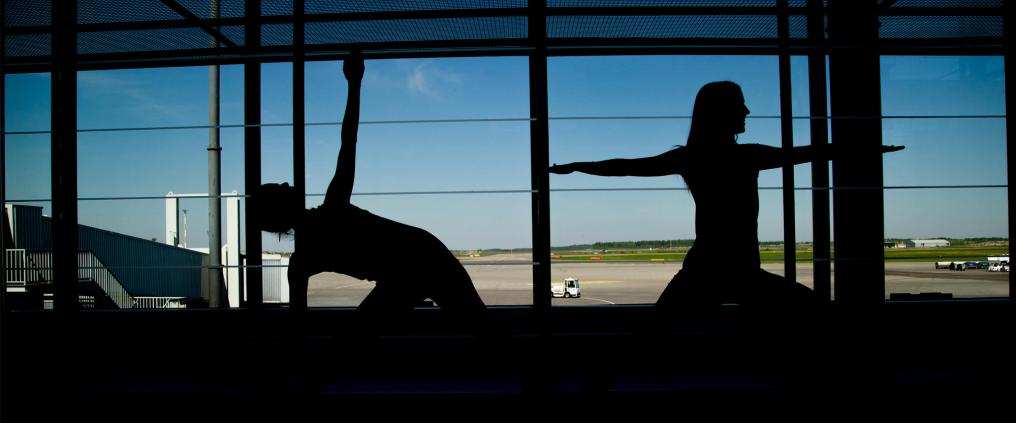 Silhouettes of persons doing yoga.