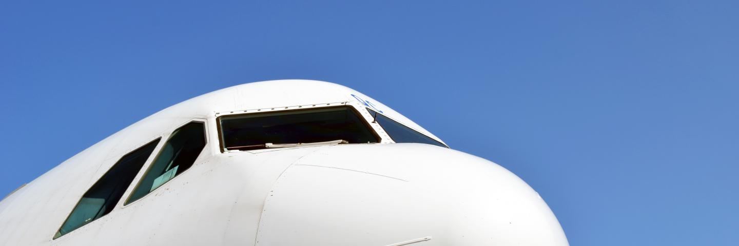 A close-up photo of a white airplane