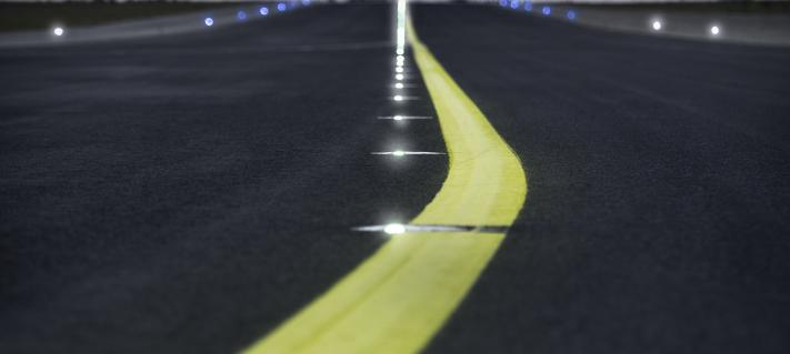 Yellow line on the runway at night.