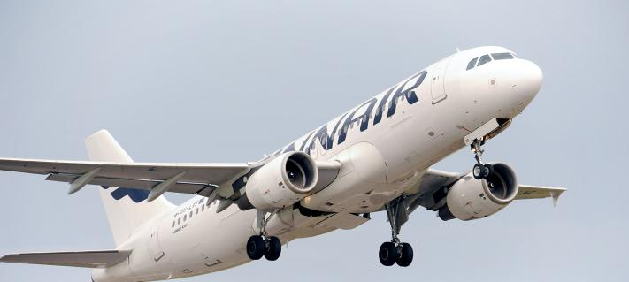 Finnair's airplane in the air.